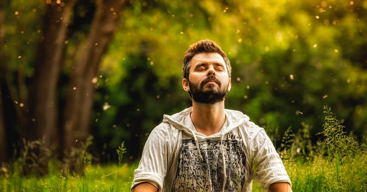 Man sitting in meditation in nature